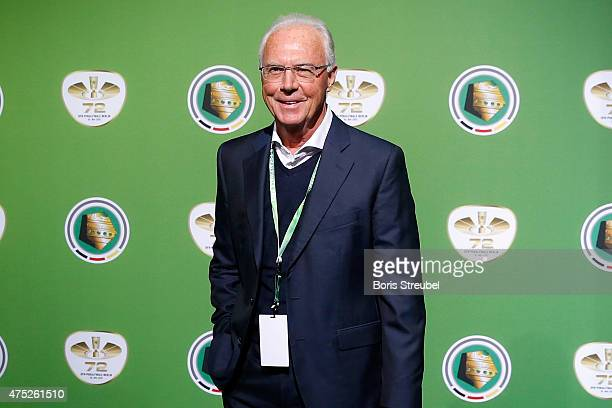 Franz Beckenbauer poses for a photo at the green carpet prior to the DFB Cup Final between Borussia Dortmund and VfL Wolfsburg at Olympiastadion on...
