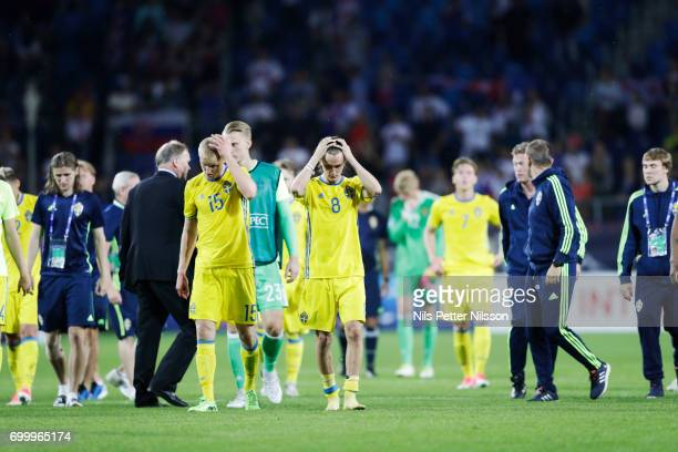 Franz Brorsson and Kristoffer Olsson of Sweden dejected after the UEFA European Under21 match between Slovakia and Sweden at Arena Lublin on June 22...