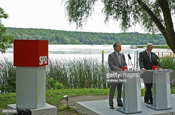 Franz Muentefering Chairman of the German Social Democrats and German Vice Chancellor and Foreign Minister FrankWalter Steinmeier speak to the media...