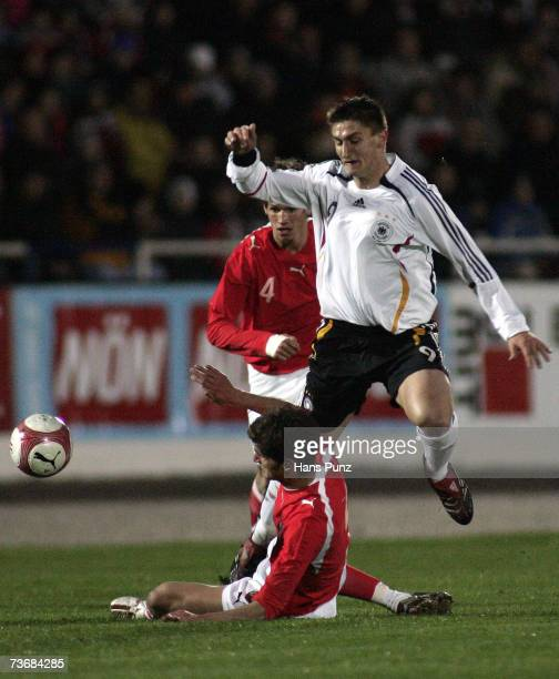Franz Schiemer of Austria tacles Mustafa Kucukovic of Germany during the Men's U21 international friendly match between Austria and Germany on March...
