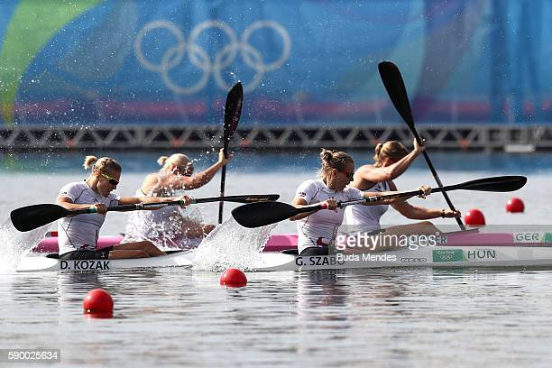 Franzi Weber and Tina Dietze of Germany compete against Gabriella Szabo and Danuta Kozak of Hungary during the Women's Kayak Double 500m Final A on...
