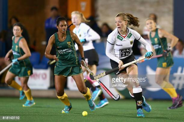 Franzisca Hauke of Germany attempts to get away from Illse Davids of South Africa during the Quarter Final match between Germany and South Africa...