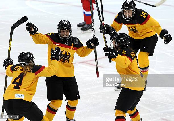 Franziska Busch of Germany celebrates with her teammates after scoring a goal in the second period against Yulia Leskina of Russia during the Women's...