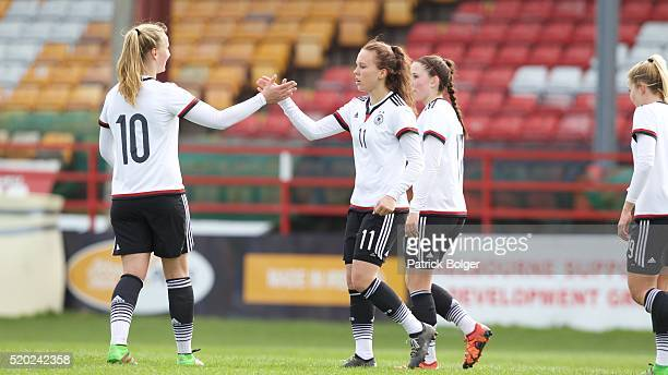 Franziska Gieseke and Viktoria Schwaim of Germany celebrate a goal during the Women's U19 Championship Elite Round match between Germany and...