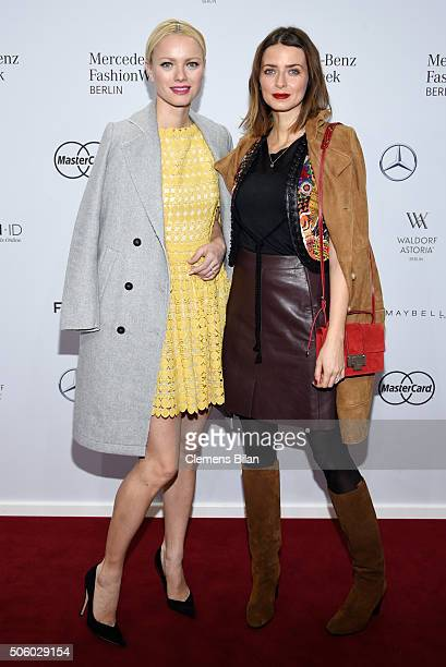 Franziska Knuppe and Eva Padberg attend the Dimitri show during the MercedesBenz Fashion Week Berlin Autumn/Winter 2016 at Brandenburg Gate on...