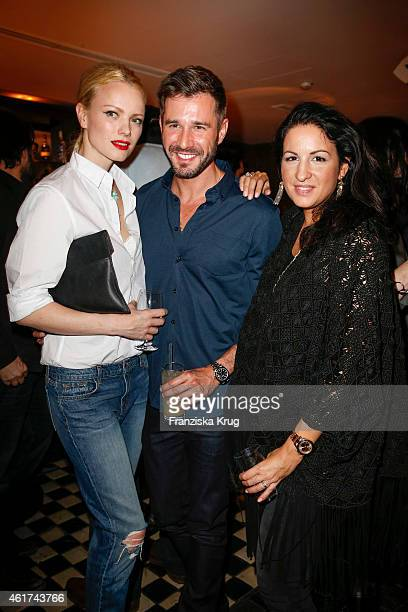 Franziska Knuppe Jochen Schropp and Minu BaratiFischer attend the J Brand Cocktail Party At Soho House Berlin on January 18 2015 in Berlin Germany