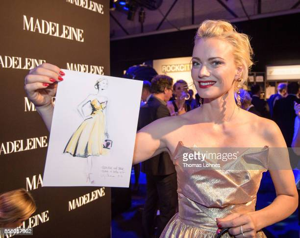 Franziska Knuppe shows her drawing made by Artist Virgina Romo during the Tribute To Bambi at Station on October 5 2017 in Berlin Germany