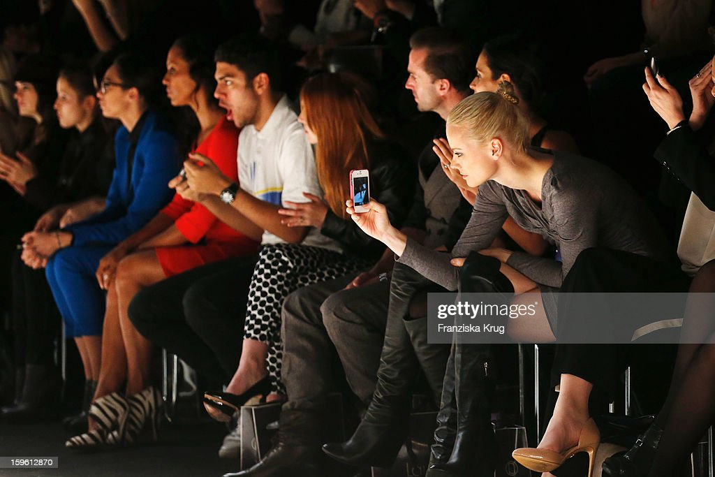 Franziska Knuppe (R) taking a picture with her cellphone at the Laurel Autumn/Winter 2013/14 fashion show during Mercedes-Benz Fashion Week Berlin at Brandenburg Gate on January 17, 2013 in Berlin, Germany.