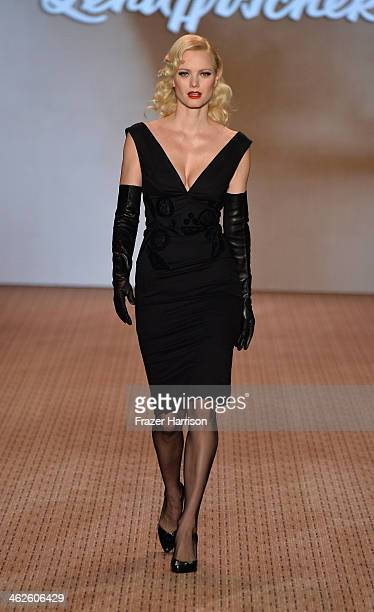 Franziska Knuppe walks the runway at Lena Hoschek show during MercedesBenz Fashion Week Autumn/Winter 2014/15 at Brandenburg Gate on January 14 2014...