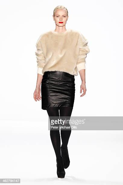 Franziska Knuppe walks the runway at the Marcel Ostertag show during MercedesBenz Fashion Week Autumn/Winter 2014/15 at Brandenburg Gate on January...