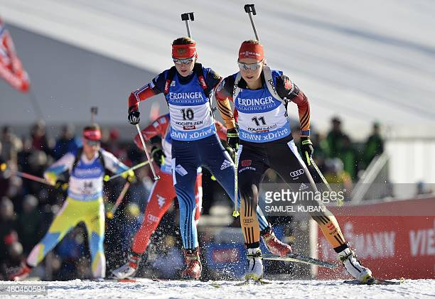 Franziska Preuss of Germany and Ekaterina Glazyrina of Russia compete during the women's10km pursuit competition of the IBU Biathlon World Cup in...