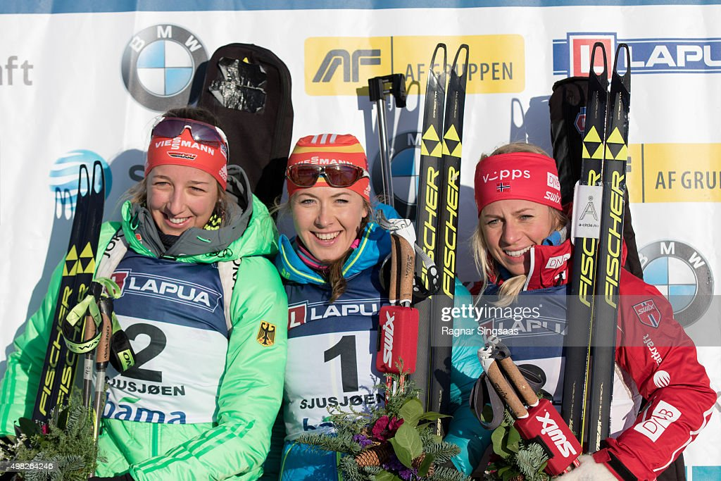 Franziska Preuss of Germany (2nd place), <a gi-track='captionPersonalityLinkClicked' href=/galleries/search?phrase=Juliya+Dzhyma&family=editorial&specificpeople=10101687 ng-click='$event.stopPropagation()'>Juliya Dzhyma</a> of Ukraine (1st place) and <a gi-track='captionPersonalityLinkClicked' href=/galleries/search?phrase=Tiril+Eckhoff&family=editorial&specificpeople=10023336 ng-click='$event.stopPropagation()'>Tiril Eckhoff</a> of Norway (3rd place) celebrate on the podium after the Women's 12.5 kilometer mass start race of the Season Start Biathlon on November 22, 2015 in Sjusjoen, Norway.