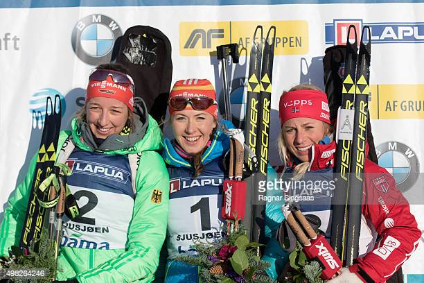Franziska Preuss of Germany Juliya Dzhyma of Ukraine and Tiril Eckhoff of Norway celebrate on the podium after the Women's 125 kilometer mass start...