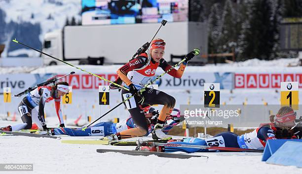 Franziska Preuss of Germany takes the lead from Ekaterina Glazyrina of Russia after the prone shooting during the women 4 x 6 km relay event in the...