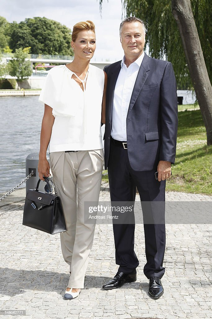 Franziska van Almsick and Juergen B Harder arrive for a boat tour with the Monaco royal couple on the Spree canal on July 9 2012 in Berlin Germany...