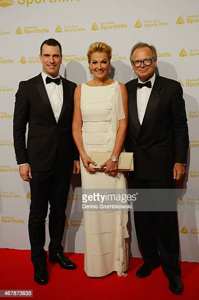 Franziska van Almsick poses with Deutsche Sporthilfe CEO Michael Illgner and Werner Klatten on her arrival at the Ball des Sports 2014 at...