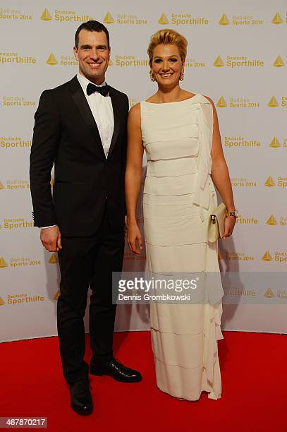 Franziska van Almsick poses with Deutsche Sporthilfe CEO Michael Illgner on her arrival at the Ball des Sports 2014 at RheinMainHalle on February 8...