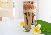 Frappe Iced Coffee Drink with plumeria