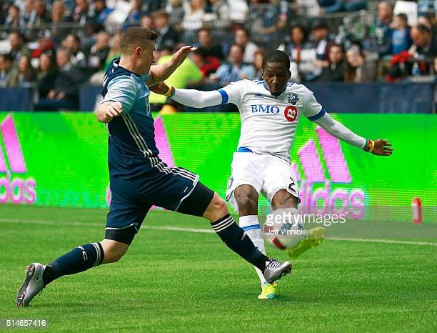 Fraser Aird of the Vancouver Whitecaps defends against Ambroise Oyongo of the Montreal Impact during their MLS game March 6 2016 at BC Place in...