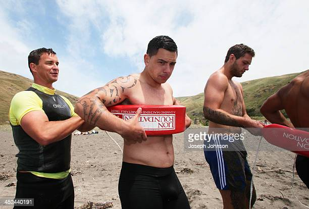 Fraser Bickley Surf Lifesaver with Rob Thompson of the Crusaders and Joel Everson during a surf lifesaving training day on November 29 2013 in...