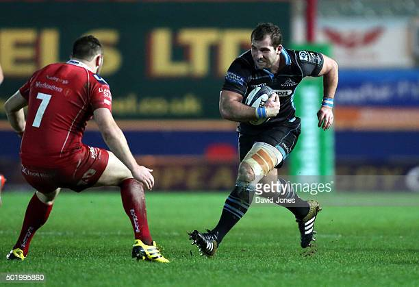 Fraser Brown of Glasgow charges at Jack Condy of Scarlets during the European Rugby Champions Cup match between Scarlets and Glasgow at the Parc y...