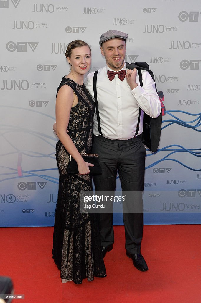 Fraser Campbell (R) and guest arrive on the red carpet at the 2014 Juno Awards on March 30, 2014 in Winnipeg, Canada.
