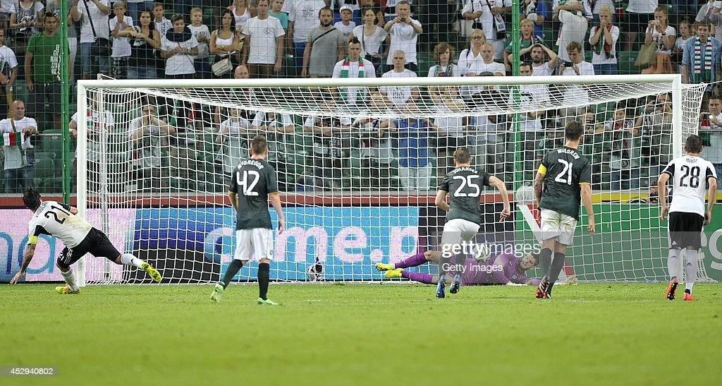 Fraser Forster goalkeeper of Celtic saves the penalty during the third qualifying round UEFA Champions League match between Legia and Celtic at Pepsi Arena on July 30, 2014 in Warsaw, Poland.