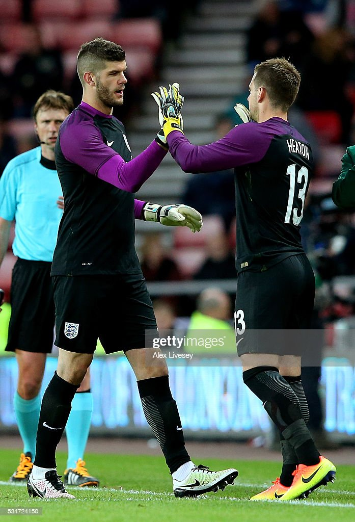 <a gi-track='captionPersonalityLinkClicked' href=/galleries/search?phrase=Fraser+Forster&family=editorial&specificpeople=4185429 ng-click='$event.stopPropagation()'>Fraser Forster</a> of England is replaced by team mate Tom Heaton during the International Friendly match between England and Australia at Stadium of Light on May 27, 2016 in Sunderland, England.