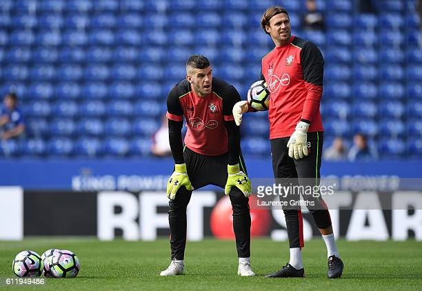 Fraser Forster of Southampton and Stuart Taylor of Southampton warm up prior to kick off during the Premier League match between Leicester City and...