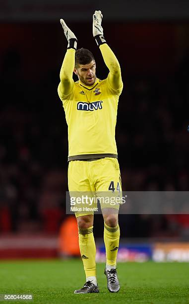 Fraser Forster of Southampton applauds the away supporters after the Barclays Premier League match between Arsenal and Southampton at the Emirates...