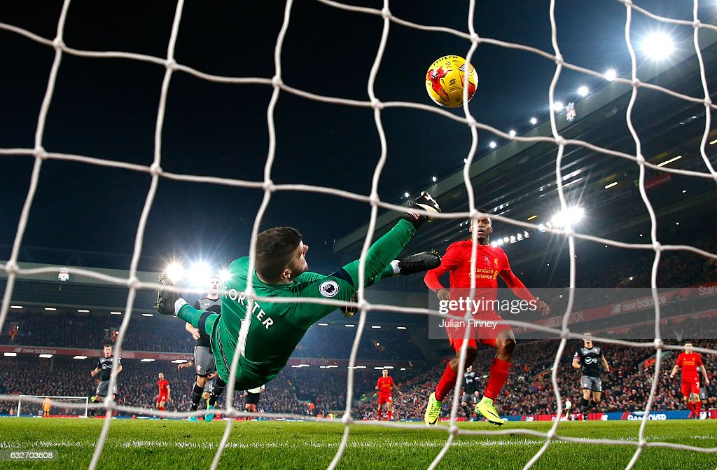 Fraser Forster of Southampton makes a save during the EFL Cup Semi-Final Second Leg match between Liverpool and Southampton at Anfield on January 25, 2017 in Liverpool, England.