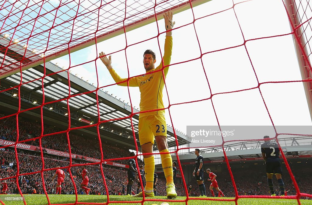 Fraser Forster of Southampton reacts after conceding a goal from Daniel Sturridge of Liverpool during the Barclays Premier League match between Liverpool and Southampton at Anfield on August 17, 2014 in Liverpool, England.