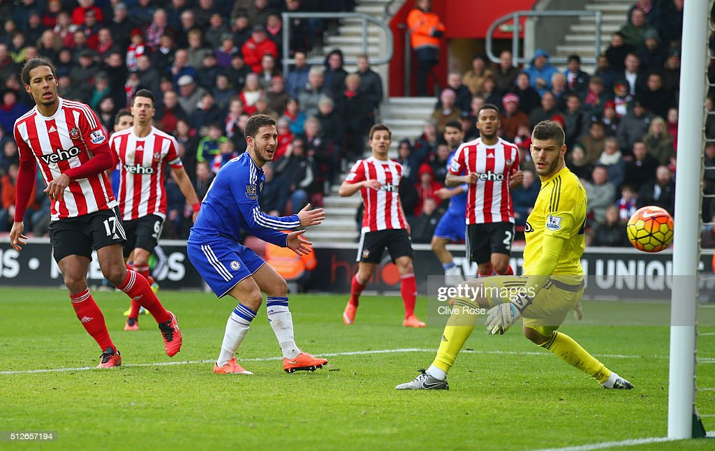 Fraser Forster (1st R) of Southampton watches the ball as Sesc Fabregas (2nd L, obscured) of Chelsea scores his team's first goal during the Barclays Premier League match between Southampton and Chelsea at St Mary's Stadium on February 27, 2016 in Southampton, England.