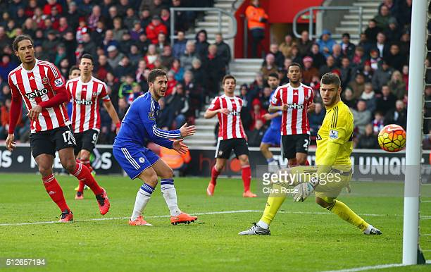 Fraser Forster of Southampton watches the ball as Sesc Fabregas of Chelsea scores his team's first goal during the Barclays Premier League match...