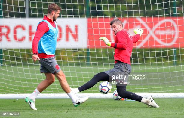 Fraser Forster saves from Jack Stephens during a Southampton FC training session at the Staplewood Campus on September 26 2017 in Southampton England