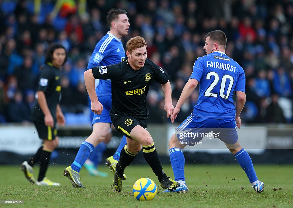 Fraser Fyvie of Wigan Athletic breaks away from Waide Fairhurst of Macclesfield Town during the Budweiser FA Cup fourth round match between Macclesfield Town and Wigan Athletic at Moss Rose Ground on January 26, 2013 in Macclesfield, England.