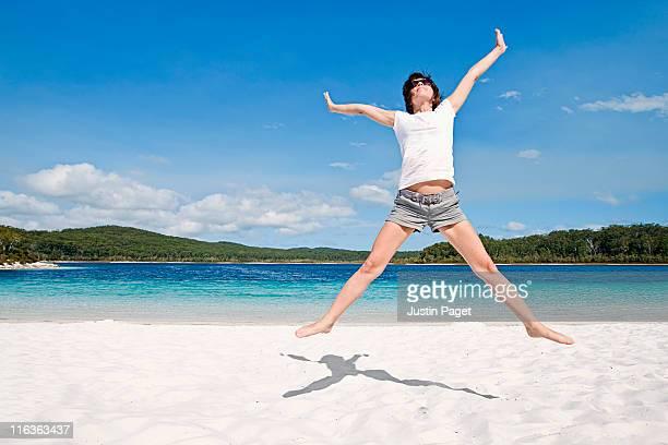 Fraser Island, Australia, Woman cheering on beach
