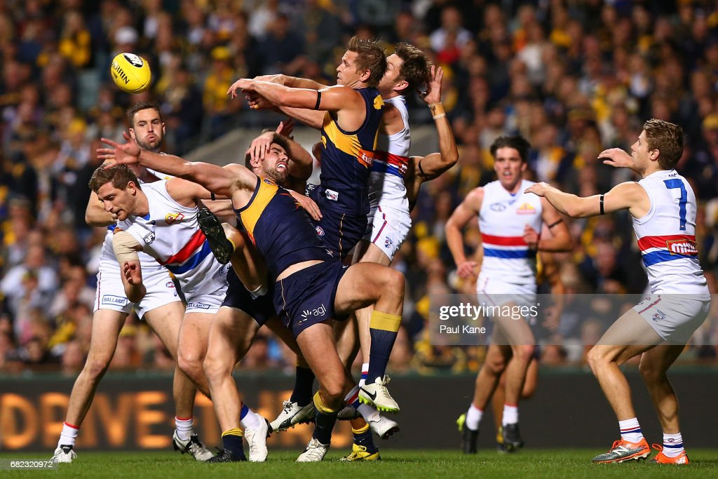 Fraser McInnes and Mark LeCras of the Eagles contest a mark against Fletcher Roberts and Matthew Boyd of the Bulldogs during the round eight AFL match between the West Coast Eagles and the Western Bulldogs at Domain Stadium on May 12, 2017 in Perth, Australia.