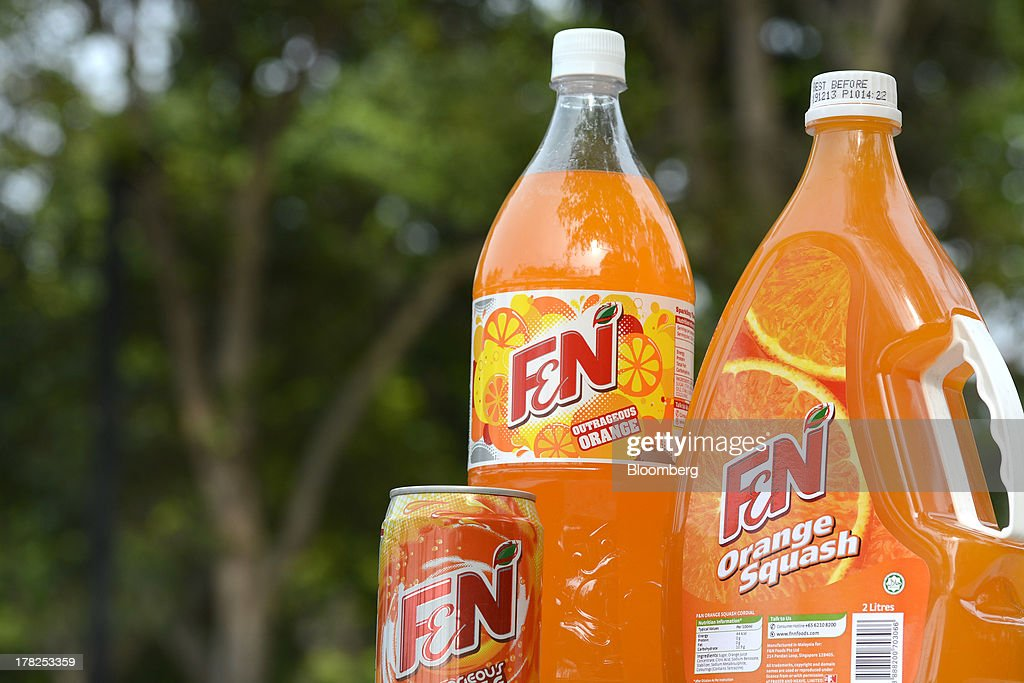 Fraser & Neave Ltd. (F&N) orange-flavored drinks are arranged for a photograph in Singapore, on Wednesday, Aug. 28, 2013. Fraser & Neave, controlled by Thailands richest man Charoen Sirivadhanabhakdi, climbed the most in five weeks on plans to spin off its property business through a Singapore listing at the end of the year. Photographer: Munshi Ahmed/Bloomberg via Getty Images