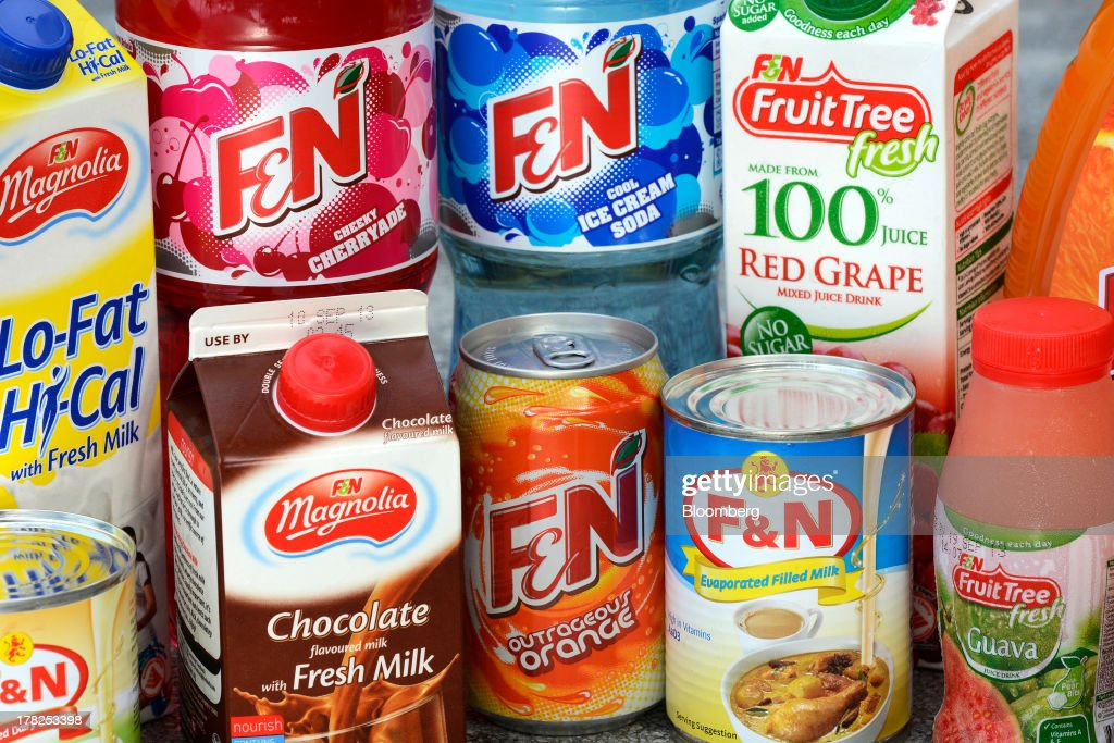 Fraser & Neave Ltd. (F&N) packaged drinks are arranged for a photograph in Singapore, on Wednesday, Aug. 28, 2013. Fraser & Neave, controlled by Thailands richest man Charoen Sirivadhanabhakdi, climbed the most in five weeks on plans to spin off its property business through a Singapore listing at the end of the year. Photographer: Munshi Ahmed/Bloomberg via Getty Images