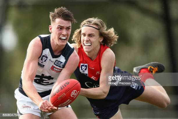 Fraser Pearce of the Northern Blues handballs during the round 16 VFL match between Casey and the Northern Blues at Casey Fields on August 12 2017 in...