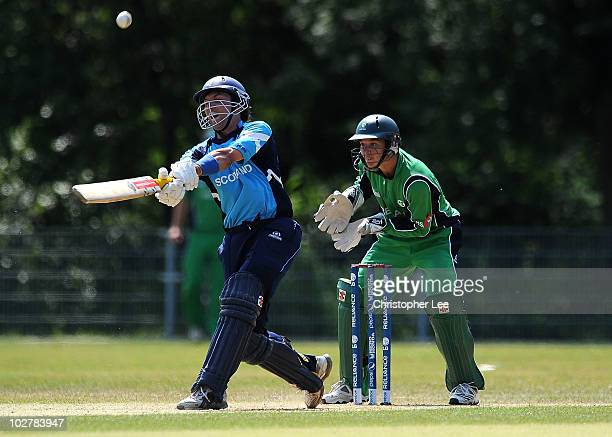Fraser Watts of Scotland hits out during the ICC World Cricket League Final between Ireland and Scotland at the VRC Amstelveen Cricket Ground on July...