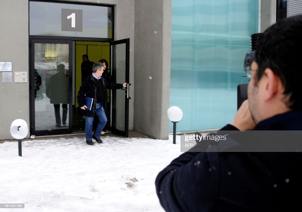 Fraud controllers of French Directorate General for Competition, Consumer Affairs and Repression of Fraud (DGCCRF) leave Comigel headquarters as a cameram films them on February 11, 2013 in Metz, eastern France. The French food company that supplied frozen lasagne found to contain up to 100 percent horsemeat to British supermarkets today shut down its website and declined to answer media enquiries. Comigel, based in the northern city of Metz, supplies frozen meals to supermarket chains and other clients in 16 countries, with Germany, the Netherlands, Belgium and Scandinavia the main markets, according to industry websites. AFP PHOTO / JEAN-CHRISTOPHE VERHAEGEN