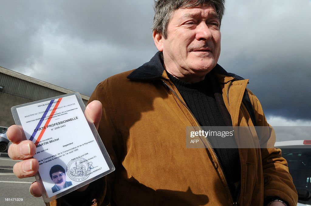 Fraud controllers of French Directorate General for Competition, Consumer Affairs and Repression of Fraud (DGCCRF), Michel Martin, shows his card as he controls the French meat supplier Spanghero's headquarters on February 11, 2013 in Castelnaudary, southern France. The Europe-wide scandal over horsemeat sold as beef spread on February 10 as leading French retailers pulled products from their shelves and threats of legal action flew. The suspect lasagne meals sold by Swedish frozen food giant Findus in Britain were made by French company Comigel using meat supplied by French meat-processing firm Spanghero. Aguerre declared that Spanghero respected the law.