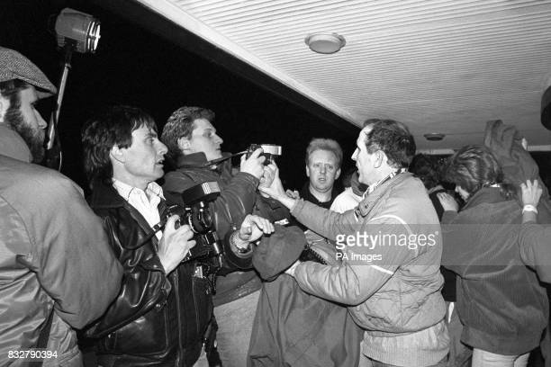 A fraught moment as press cameramen photograph the reunion of crew members from the illfated ferry Herald of Free Enterprise with relieved relatives...