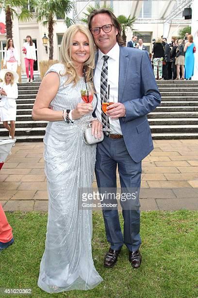 Frauke Ludowig and her husband Kai Roeffen attend the Raffaello Summer Day 2014 at Kronprinzenpalais on June 21 2014 in Berlin Germany