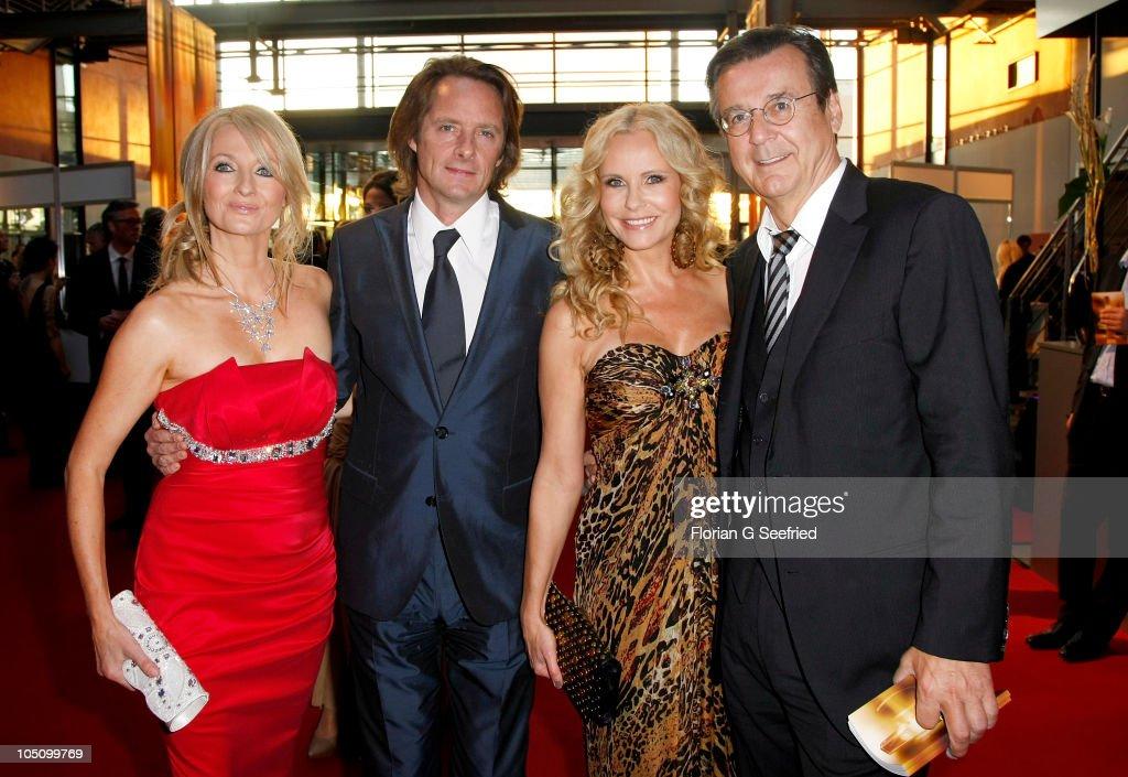 Frauke Ludowig and husband Kai Roeffen, Katja Burkard and Hans Mahr attend the German TV Award 2010 (Deutscher Fernsehpreis 2010) at Coloneum on October 9, 2010 in Cologne, Germany.