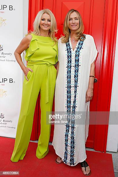 Frauke Ludowig and Tatjana Patitz during the 'Stargefluester' photo call at Hair Beauty Galerie on August 23 2015 in Munich Germany