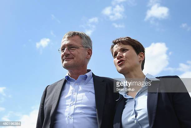 Frauke Petry and Joerg Meuthen the new cospeakers and main leaders of the Alternative fuer Deutschland political party pose for photographers after...