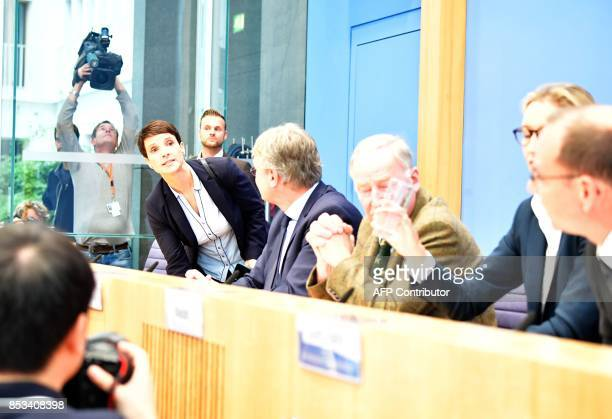 Frauke Petry coleader of Germany's nationalist Alternative for Germany party leaves a running press conference with AfD coleader Joerg Meuthen AfD...